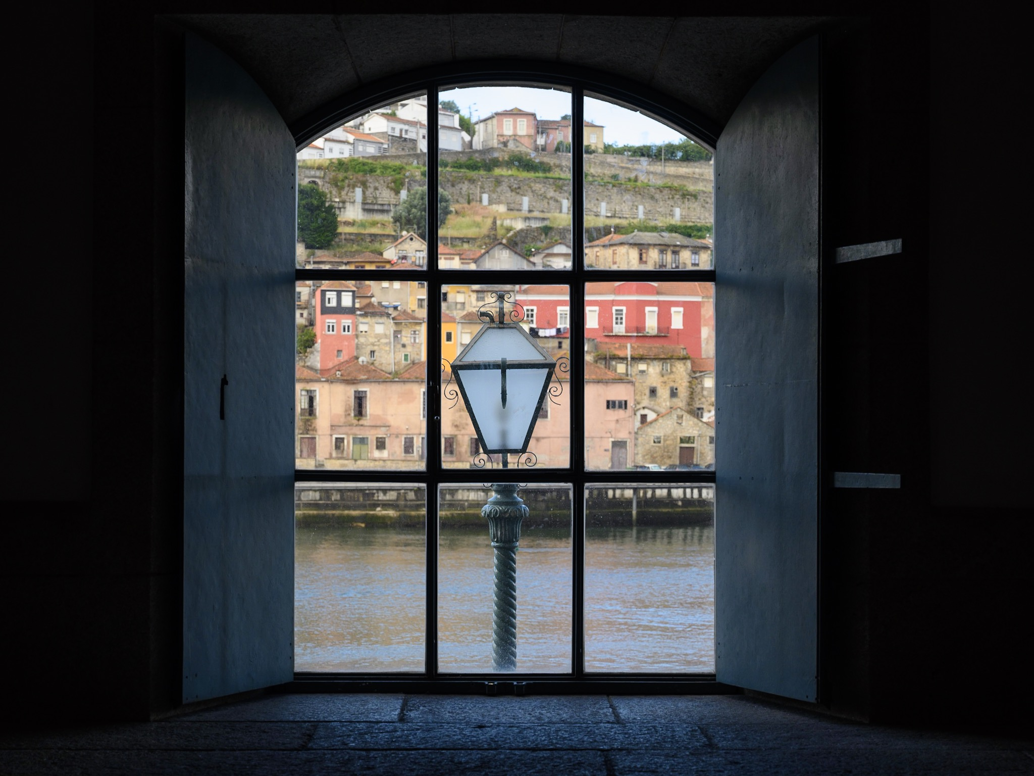 Look through a window across a river in Porto, Portugal